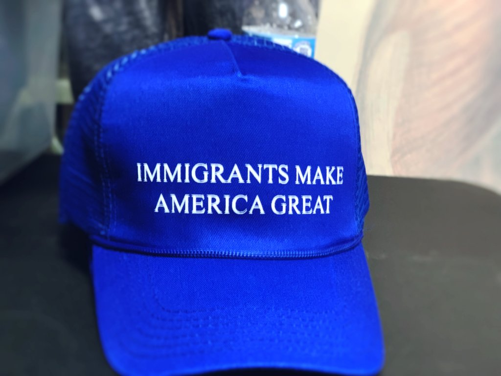 Hat with words Immigrant make America great