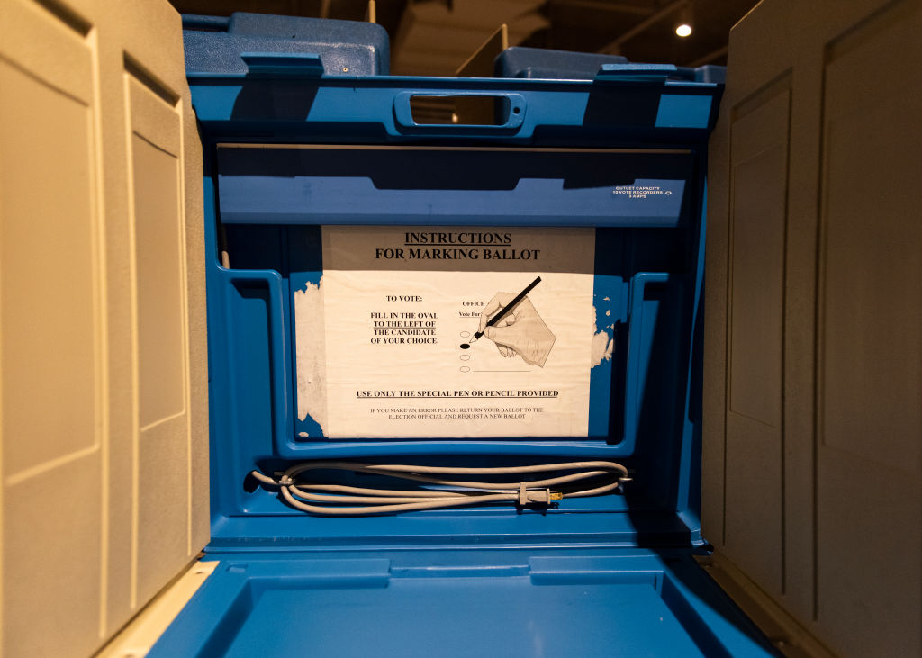 voting booth with instructions