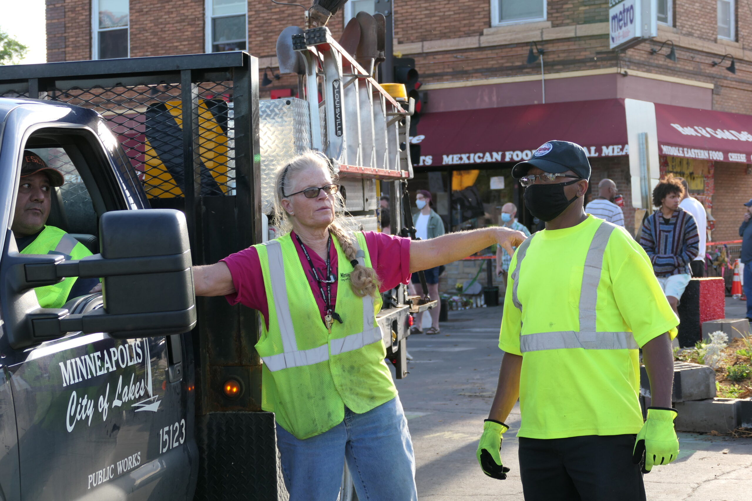 City workers work to reopen George Floyd Square to traffic